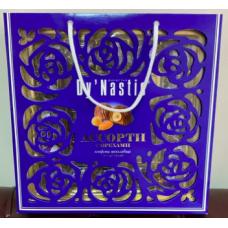 Конфеты Ассорти с орехами в молочном шоколаде сумка 210г узоры